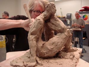 - The picture above demonstrates an artist sculpting.